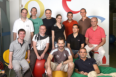 The Google Trends team in Tel Aviv; they're gathered against a wall with the word