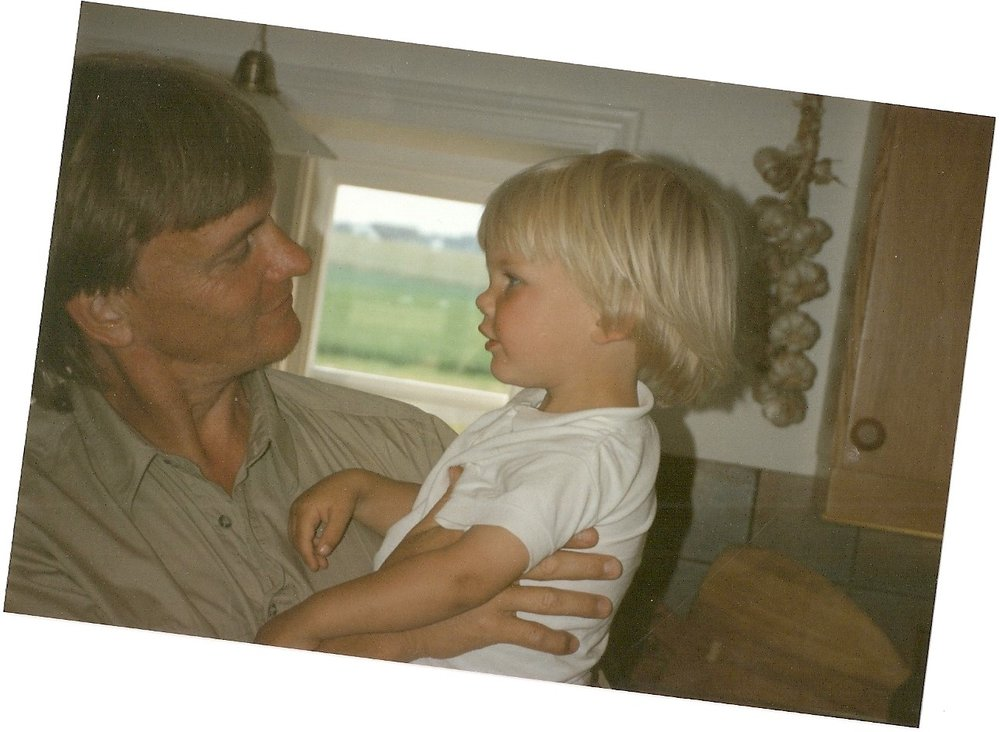 A photography showing Klas holding Tim as a wrong child.